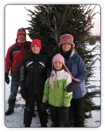 Fallowfield Tree Farm - Family enjoying an outing at our cut-your-own Christmas Tree Farm - Fallowfield Tree Farm - 613.720.3451
